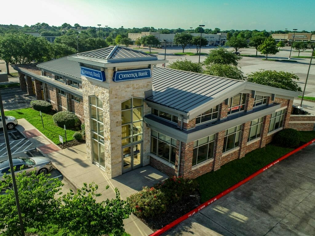 Commercial Real Estate - Aerial photo of shopping center on the market in Pasadena, TX